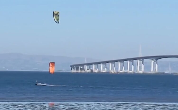 Evan relaunches a lost kite, flies two kites at once, rides upwind